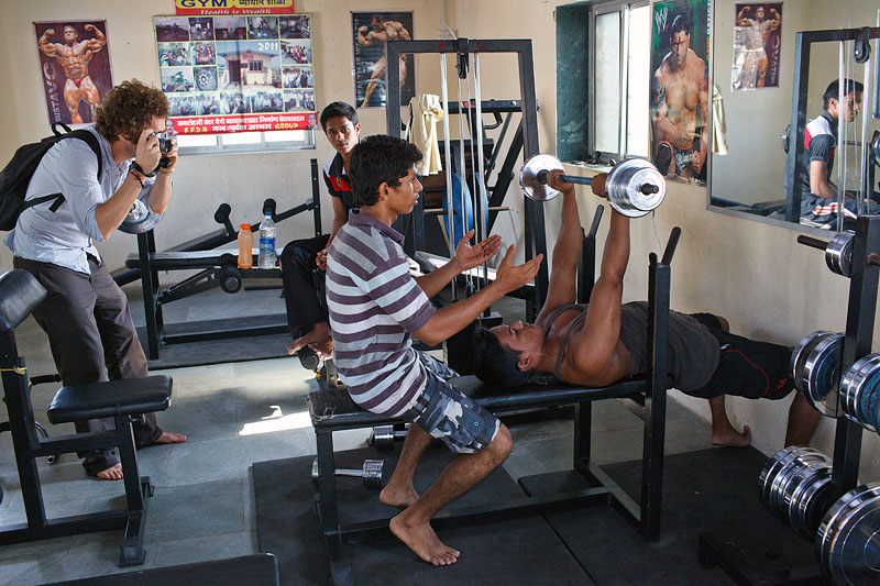 Workshop participant Nicolas photographs in a small gym in Mumbai.