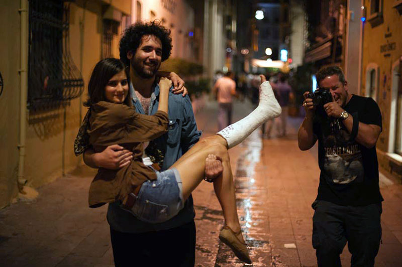 Gareth and a young couple on a Friday night in Beyoglu.