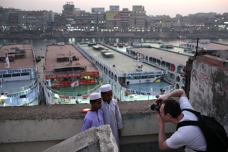 Photographer Kristian Leven takes a picture of young boys in Dhaka, Bangladesh.